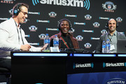 (L-R) Brady Quinn, Xavier Rhodes and Bruce Gradkowski attend SiriusXM at Super Bowl LIII Radio Row on January 31, 2019 in Atlanta, Georgia.