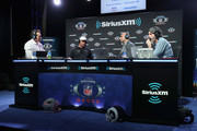 (L-R) Brady Quinn, Russell Wilson, Bruce Gradkowski and Bruce Murray attend SiriusXM at Super Bowl LIII Radio Row on January 31, 2019 in Atlanta, Georgia.