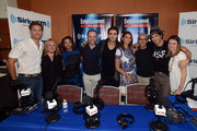 Matthew Davis, Julie Plec, Kat Graham, Mario Correa, Paul Wesley, Nina Dobrev, Jess Cagle, Ian Somerhalder and Julia Cunningham pose after being interviewed on SiriusXM's Entertainment Weekly Radio channel from Comic-Con 2014 at The Hard Rock Hotel on July 26, 2014 in San Diego, California.