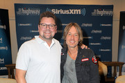 (L-R) Storme Warren and Keith Urban attend the SiriusXM's The Highway broadcast backstage leading up to the Academy of Country Music Awards at MGM Grand Garden Arena on April 6, 2019 in Las Vegas, Nevada.