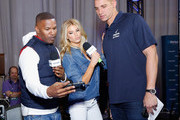 Actor/recording artist Jamie Foxx, model Charlotte McKinney and New Orleans Saints tight end Jimmy Graham attend SiriusXM at Super Bowl XLIX Radio Row at the Phoenix Convention Center on January 30, 2015 in Phoenix, Arizona.