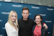 Actress Dakota Fanning and actor Ewan McGregor take part in SiriusXM's Town Hall with the cast of 'American Pastoral' hosted by EW's Sara Vilkomerson (R) at the SiriusXM Studio on October 19, 2016 in New York City.