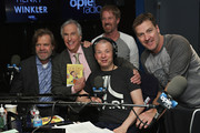 Actors William H. Macy (L) and Henry Winkler (2L) pose for a photo with hosts Jim Norton (C), Greg 'Opie' Hughes (back row C) and Jim Florentine (R) during a visit to the 'Opie and Jim Norton Show' on Opie Radio at SiriusXM Studios on March 14, 2016 in New York City.