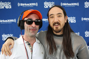 """Steve Aoki (R) and Danny Valentino attend SiriusXM's """"UMF Radio"""" at the SiriusXM Music Lounge at W South Beach on March 27, 2014 in Miami Beach, Florida."""