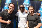 """Reggie Bush (C) poses with Axwell and Ingrosso at SiriusXM""""s """"UMF Radio"""" Broadcast Live From The SiriusXM Music Lounge at W Hotel on March 26, 2015 in Miami, Florida."""