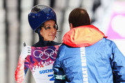 Shelley Rudman of Great Britain speaks to her coach after a run during the Women's Skeleton heats on Day 6 of the Sochi 2014 Winter Olympics at Sliding Center Sanki on February 13, 2014 in Sochi, Russia.