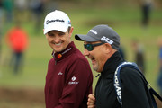 Justin Rose of England and his caddie Mark Fulcher share a joke during Day One of Sky Sports British Masters at Walton Heath Golf Club on October 11, 2018 in Tadworth, England.