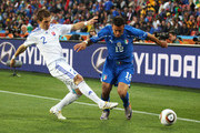 Fabio Quagliarella of Italy and Peter Pekarik of Slovakia battle for the ball during the 2010 FIFA World Cup South Africa Group F match between Slovakia and Italy at Ellis Park Stadium on June 24, 2010 in Johannesburg, South Africa.