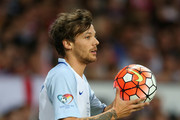 Louis Tomlinson of England takes a throw in during the Soccer Aid 2016 match in aid of UNICEF at Old Trafford on June 5, 2016 in Manchester, England.