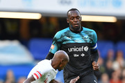Usain Bolt of Soccer Aid World XI is takes on Sir Mo Farah of England during the Soccer Aid for UNICEF 2019 match between England and the Soccer Aid World XI at Stamford Bridge on June 16, 2019 in London, England.