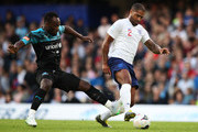 Glen Johnson of England evades Michael Essien of Soccer Aid World XI during the Soccer Aid for UNICEF 2019 match between England and the Soccer Aid World XI at Stamford Bridge on June 16, 2019 in London, England.