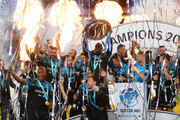 Usain Bolt of Soccer Aid World XI lifts the trophy as Soccer Aid World XI are victorious in the penalty shoot out after the Soccer Aid for UNICEF 2019 match between England and the Soccer Aid World XI at Stamford Bridge on June 16, 2019 in London, England.