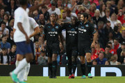 Clarence Seedorf of the Rest of the World (C) celebrates as he scores their third goal with Patrick Kluivert of the Rest of the World and Robert Pires of the Rest of the World during the Soccer Aid for UNICEF 2018 match between Englannd and the Rest of the World at Old Trafford on June 10, 2018 in Manchester, England.