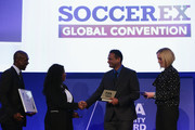 The first-ever FIFA Diversity Award is presented to India for 'Slum Soccer' by Fatma Samba Diouf Samoura, FIFA Secretary General and Clarence Seedorf, former Netherlands International during day 1 of the Soccerex Global Convention 2016 at Manchester Central Convention Complex on September 26, 2016 in Manchester, England.