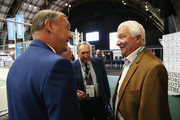 Former Manchester City footballer Mike Summerbee (R) talks to Paul Duffen (L), former Chairman of Hull City and Gerard Houllier, Red Bull Head of Global Football during day 1 of the Soccerex Global Convention 2016 at Manchester Central Convention Complex on September 26, 2016 in Manchester, England.