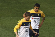 Harry Kewell of Australia controls the ball as Tim Cahill looks on during an Australian Socceroos training session at St Stithians College on May 31, 2010 in Sandton, South Africa.