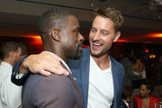 Sterling K. Brown (L) and Justin Hartley attend the 2018 Pre-Emmy Party hosted by Entertainment Weekly and L'Oreal Paris at Sunset Tower on September 15, 2018 in Los Angeles, California.