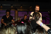 (L-R) Daniel Damico, Nick Adams, David Cook, and Monty Anderson perform at the Soles4Souls charity concert, sponsored by Barefoot Wine & Bubbly at the Bridge Building on April 1, 2014 in Nashville, Tennessee.
