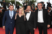"""Clovis Cornillac, director Andrea Bescond,Eric Metayer and a guest of """"Little Tickles"""" (Les Chatouilles) attend the screening of """"Solo: A Star Wars Story"""" during the 71st annual Cannes Film Festival at Palais des Festivals on May 15, 2018 in Cannes, France."""