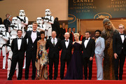 """(L-R) Producer Simon Emanuel, Joonas Suotamo, Thandie Newton, Woody Harrelson, Cannes Film Festival Director Thierry Fremaux,  Ron Howard, Emilia Clarke, Alden Ehrenreich, Donald Glove, Chewbacca and (in costume) and Paul Bettany attends the screening of """"Solo: A Star Wars Story"""" during the 71st annual Cannes Film Festival at Palais des Festivals on May 15, 2018 in Cannes, France."""