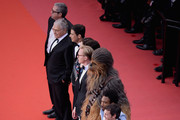 """Joonas Suotamo, Thandie Newton, Woody Harrelson, Ron Howard, Emilia Clarke, Alden Ehrenreich, Donald Glover, Chewbacca, Paul Bettany, Phoebe Waller-Bridge and Kathleen Kennedy attend the screening of """"Solo: A Star Wars Story"""" during the 71st annual Cannes Film Festival at Palais des Festivals on May 15, 2018 in Cannes, France."""