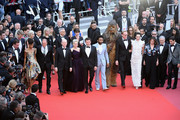 """Producer Simon Emanuel, actress Thandie Newton, actor Woody Harrelson, director Ron Howard, actress Emilia Clarke, actors Alden Ehrenreich, Donald Glover, Chewbacca, actor Paul Bettany, actress Phoebe Waller-Bridge, producer Kathleen Kennedy, screenwriter Jonathan Kasdan and writer Lawrence Kasdan attend the screening of """"Solo: A Star Wars Story"""" during the 71st annual Cannes Film Festival at Palais des Festivals on May 15, 2018 in Cannes, France."""