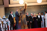 """(L-R) Producer Simon Emanuel, actor Joonas Suotamo, Chewbacca, actress Thandie Newton, actor Woody Harrelson, director Ron Howard, actress Emilia Clarke, actor Alden Ehrenreich, actor Donald Glover and actress Phoebe Waller-Bridge attend the screening of """"Solo: A Star Wars Story"""" during the 71st annual Cannes Film Festival at Palais des Festivals on May 15, 2018 in Cannes, France."""