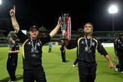 Darren Maddy and Imran Tahir of Warwickshire hold the trophy during the Clydesdale Bank 40 Final match between Somerset and Warwickshire at Lord's Cricket Ground on September 18, 2010 in London, England.