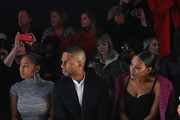 (L-R) Singer Tashiana Washington, actors Eric West and Vicky Jeudy attend the Son Jung Wan Fall 2016 fashion show during New York Fashion Week: The Shows at The Dock, Skylight at Moynihan Station on February 13, 2016 in New York City.