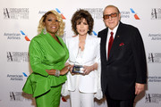 Patti LaBelle, Carole Bayer Sager, and Clive Davis pose backstage during the Songwriters Hall Of Fame 50th Annual Induction And Awards Dinner at The New York Marriott Marquis on June 13, 2019 in New York City.