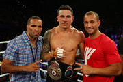 Anthony Mundine, Sonny Bill Williams and Quade Cooper celebrate after Sonny Bill Williams heavyweight bout win against Francois Botha at the Brisbane Entertainment Centre on February 8, 2013 in Brisbane, Australia.