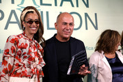Ferzan Ozpetek receives his award with Nina Zilli (L) at the Soundtrack Awards during the 76th Venice Film Festival at Excelsior Hotel on September 04, 2019 in Venice, Italy.