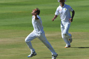 Imran Tahir (L) of South Africa celebrates after claiming the wicket of Kumar Sangakkara of Sri Lanka for 34 runs during day three of the third Test match between South Africa and Sri Lanka at Sahara Park Newlands on January 5, 2012 in Cape Town, South Africa.