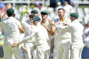 Josh Hazlewood of Australia celebrates the wicket of Hashim Amla of South Africa  during day 1 of the 3rd Sunfoil Test match between South Africa and Australia at PPC Newlands on March 22, 2018 in Cape Town, South Africa.