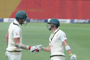 Tim Paine of Australia celebrates the 50 runs with Josh Hazlewood of Australia during day 3 of the 4th Sunfoil Test match between South Africa and Australia at Bidvest Wanderers Stadium on April 01, 2018 in Johannesburg, South Africa.