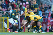 Bryan Habana of South Africa takes on Adam Ashley-Cooper and Trevita Kuridrani (R) during The Rugby Championship match between the  South African Springboks and the Australian Wallabies at Newlands Stadium on September 27, 2014 in Cape Town, South Africa.