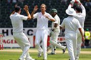 Stuart Broad of England celebrates with Kevin Pietersen, Matt Prior, and Jonathan Trott after taking the wicket of Ashwell Prince of South Africa for 19 runs when he was caught out by Graeme Swann of England during day two of the fourth test match between South Africa and England at The Wanderers Cricket Ground on January 15, 2010 in Johannesburg, South Africa.