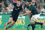 Israel Dagg of the All Blacks takes on Marcell Coetzee  during the Rugby Championship match between the South African Springboks and the New Zealand All Blacks at Ellis Park Stadium on October 4, 2014 in Johannesburg, South Africa.