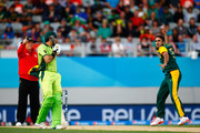 Imran Tahir of South Africa celebrates his wicket of Wahab Riaz of Pakistan (L) during the 2015 ICC Cricket World Cup match between South Africa and Pakistan at Eden Park on March 7, 2015 in Auckland, New Zealand.