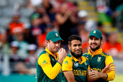 Imran Tahir of South Africa (C) celebrates his wicket of Wahab Riaz of Pakistan with AB de Villiers (L) and Rilee Rossouw (R) during the 2015 ICC Cricket World Cup match between South Africa and Pakistan at Eden Park on March 7, 2015 in Auckland, New Zealand.