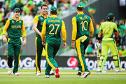 Kyle Abbott of South Africa celebrates with AB de Villiers, Rilee Rossouw and David Miller of South Africa after claiming the wicket of Sohaib Maqsood of Pakistan during the 2015 ICC Cricket World Cup match between South Africa and Pakistan at Eden Park on March 7, 2015 in Auckland, New Zealand.