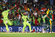 Wahab Riaz of Pakistan celebrates with Ahmad Shahzad of Pakistan after claiming the last wicket of  Imran Tahir of South Africa to win the 2015 ICC Cricket World Cup match between South Africa and Pakistan at Eden Park on March 7, 2015 in Auckland, New Zealand.