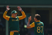 David Miller and Kyle Abbott of South Africa celebrate after taking the wicket of Thisara Perera of Sri Lanka during the 2015 ICC Cricket World Cup match between South Africa and Sri Lanka at Sydney Cricket Ground on March 18, 2015 in Sydney, Australia.