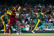 Imran Tahir of South Africa celebrates taking the wicket of Lendl Simmons of West Indies during the 2015 ICC Cricket World Cup match between South Africa and the West Indies at Sydney Cricket Ground on February 27, 2015 in Sydney, Australia.
