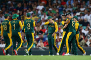 Imran Tahir of South Africa celebrates with team mates after taking the wicket of Lendl Simmons of West Indies during the 2015 ICC Cricket World Cup match between South Africa and the West Indies at Sydney Cricket Ground on February 27, 2015 in Sydney, Australia.