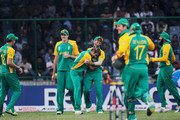 Imran Tahir of South Africa celebrates with team mate Jean-Paul Duminy after taking the wicket of Thomas of West Indies during the 2011 ICC World Cup Group B match between West Indies and South Africa at Feroz Shah Kotla Stadium on February 24, 2011 in Delhi, India.