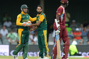 Imran Tahir of South Africa celebrates his fourth wicket with AB de Villiers during the 3rd Momentum ODI between South Africa and West Indies at Buffalo Park on January 21, 2015 in East London, South Africa.