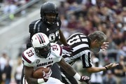 David Williams #33 of the South Carolina Gamecocks scampers past Alonzo Williams #83 of the Texas A&M Aggies knocking down a referee in the first quarter of a NCAA football game at Kyle Field on October 31, 2015 in College Station, Texas.