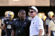 Head coach Derek Mason of the Vanderbilt Commodores greets head coach Steve Spurrier of the South Carolina Gamecocks prior to a game at Vanderbilt Stadium on September 20, 2014 in Nashville, Tennessee.