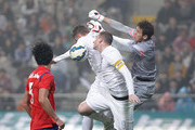 Christopher Wood of New Zealand compete for the ball with Kim Jin-Hyeon and Kwak Tae-Hwi of South Korea during the international friendly match between South Korea and New Zealand at Seoul World Cup Stadium on March 31, 2015 in Seoul, South Korea.